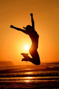 Happy Woman Jumping And Sun